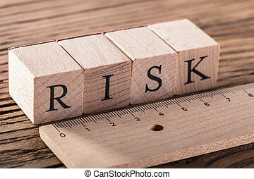 Risk Concept With Wooden Ruler
