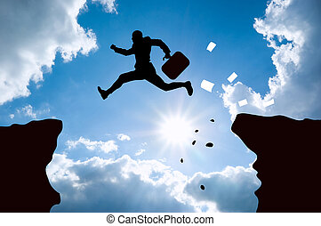 jumping bussines man against blue sky.