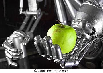Robot hand holding green apple