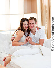 Romantic couple finding out results of a pregnancy test