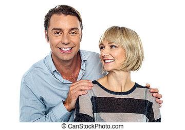 Romantic lady admiring her smart looking husband