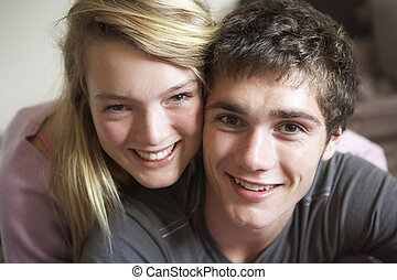 Romantic Teenage Couple Smiling At Camera