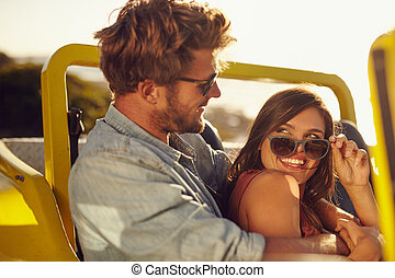 Romantic young couple having fun on a road trip