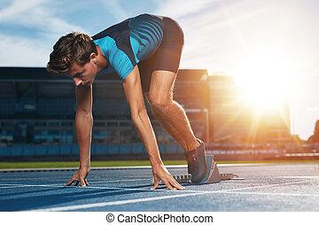 Runner on the mark at starting line