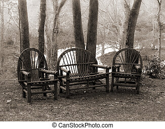 rustic twig lawn chairs/ patio furniture in the woods in sepia