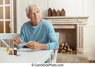 Sad aged man looking aside