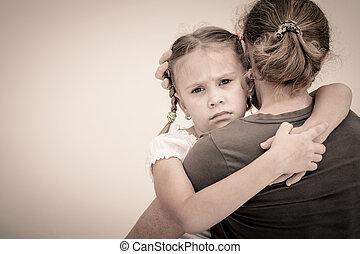 sad daughter hugging his mother