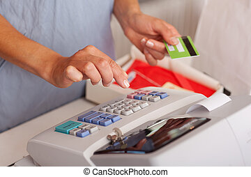 Saleswoman Holding Credit Card While Using Etr Machine