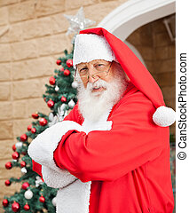 Santa Clause Standing Arms Crossed Outside House