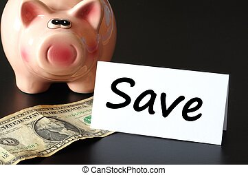save money concept with piggy bank on black