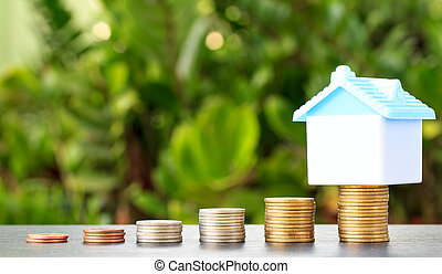 Saving to buy a house that stack coin growing ,saving money or money growth concept