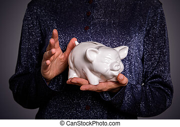 Savings and finance concept. Piggy bank in hands