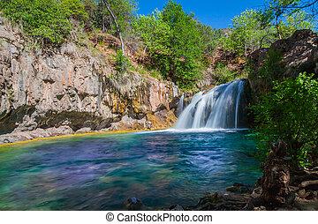 a scenic waterfall along fossil creek in northern arizona