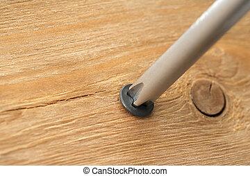screw in wooden plank