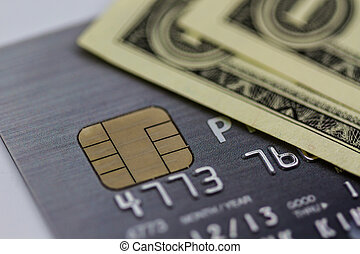 Secure chip of credit card cover with dollar banknotes.