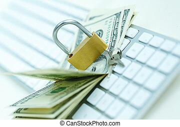 Security lock on dollar bills with white computer keyboard