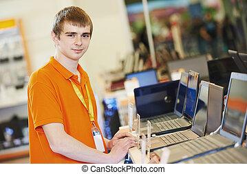 Seller at computer store