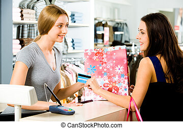 Image of salesperson selling something to attractive buyer