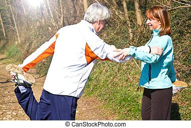 Senior couple doing their running exercises.