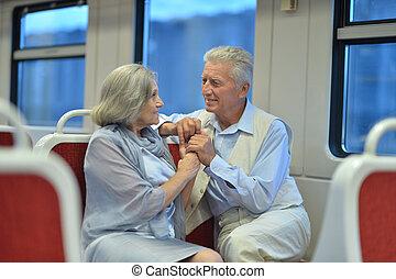 Senior couple in train