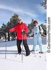 senior couple on a ski vacation