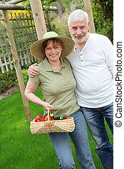 Senior couple standing in kitchen garden