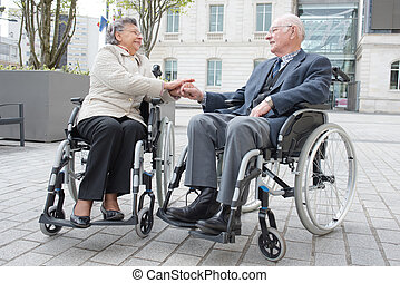 senior disabled couple outdoors