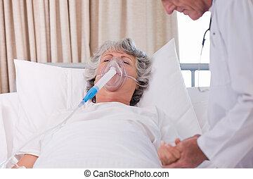 Senior doctor with his sick patient