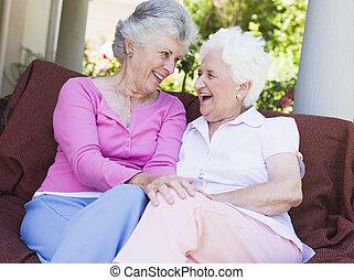 Senior female friends chatting together