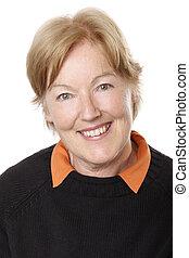Senior lady smiling looking straight at camera