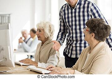 Senior lady talking to lecturer