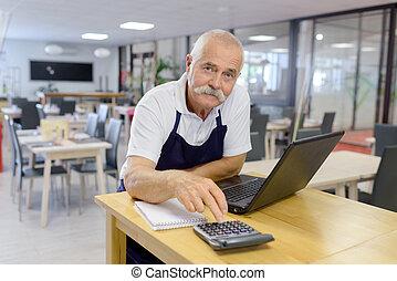 senior male hardware store worker