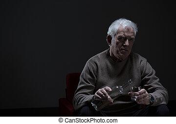 Senior man addicted to alcohol