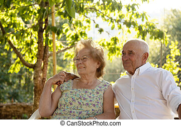 senior man and woman couple outdoors