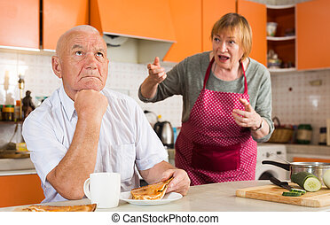 Senior man and woman quarreling