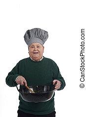 Senior man cooking on white