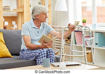 Senior man ill at home