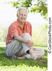 Senior man sitting outdoors
