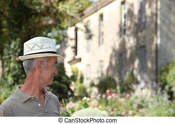 Senior man standing outdoors