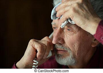 Senior man talking on phone