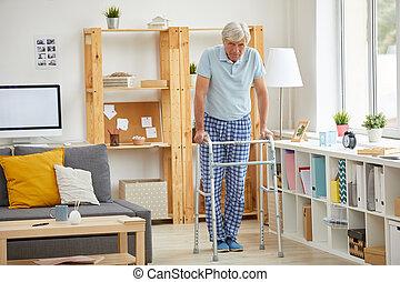 Senior man trying to walk