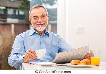 Senior man with a newspaper