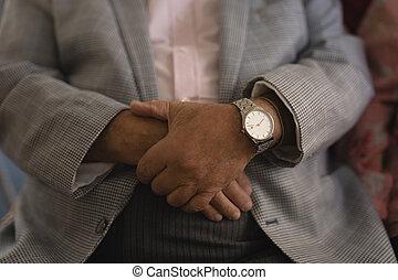 Senior man with folded hands at nursing home