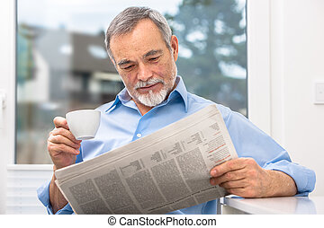 Senior man with newspaper