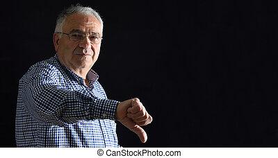 Senior Man with thumb down