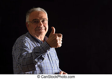 senior man with thumb up;