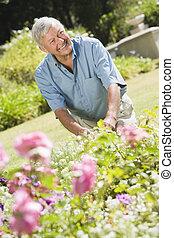 Senior man working in garden