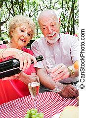 Senior Picnic - Pouring Champagne