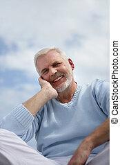 senior relaxing outdoors