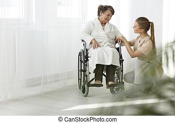 Senior smiling at her nurse